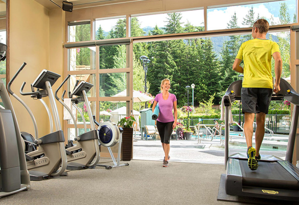 Health Club gym with people working out.