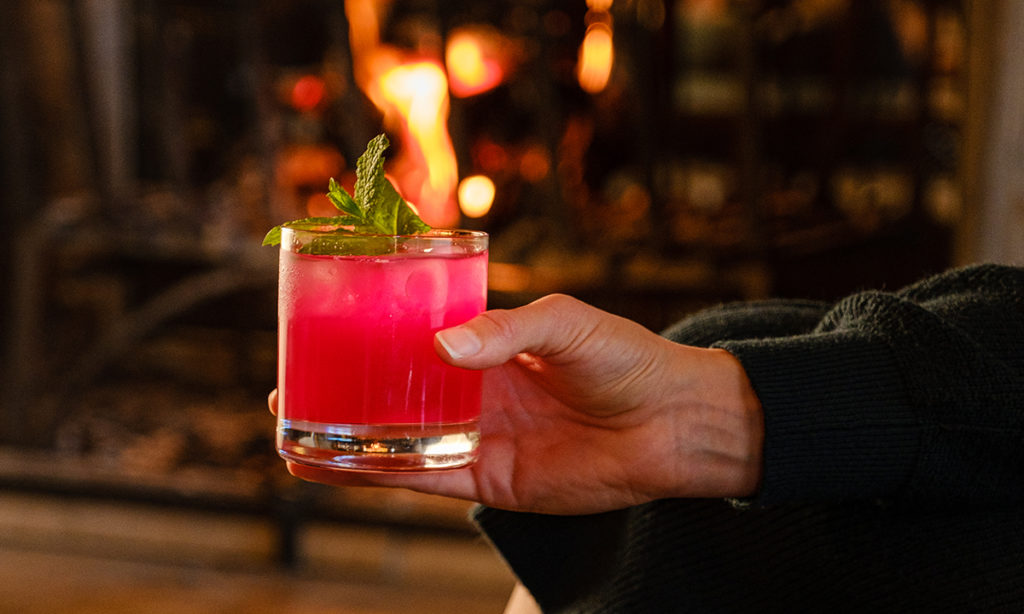 Enjoy fireside cocktails and live music in The Mallard Lounge