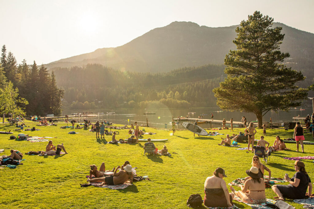 A lakeside park with people having picnics in Whistler BC.