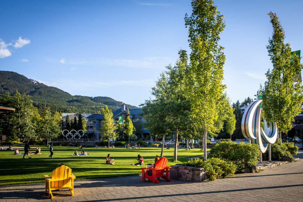 Grass lawn and mountain views at Whistler's Olympic Plaza.